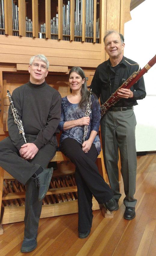 Woodwind Trio — Matthew White on clarinet, Craig Vandewater on bassoon, and Darlene Vandewater on oboe.