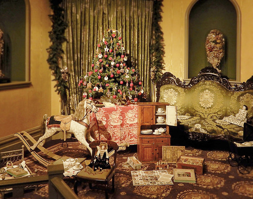 """'TIS THE SEASON — A room is decorated with a tree and toys out in the Fountain Elms mansion at the Munson-Williams-Proctor Arts Institute in Utica for a series of Christmas-season tours. This year's theme is """"A New York State Christmas."""""""