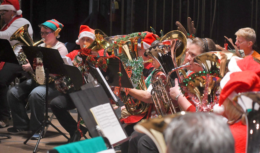 """HOLIDAY BRASS — Tuba players, adorned in holiday attire, perform in last year's annual festive favorite """"A Tuba Christmas"""" at the Capitol Theatre."""