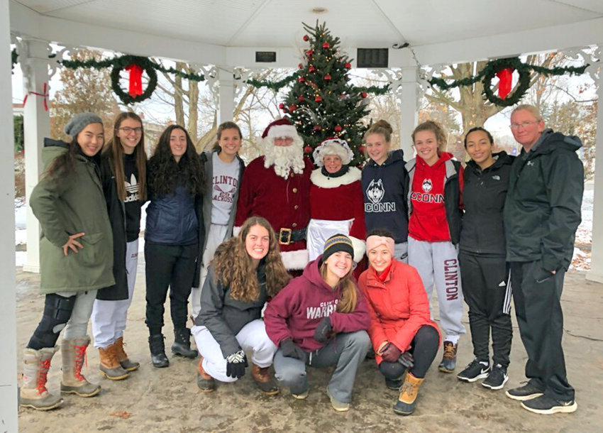 SANTA'S HELPERS — The Clinton varsity girls basketball team volunteered at the annual Clinton Shoppers' Stroll on Saturday, Nov. 24, giving out S'mores donated by Nola's Restaurant and hot chocolate donated by Krizia Martion. Donations were collected and given in support of The Country Pantry.