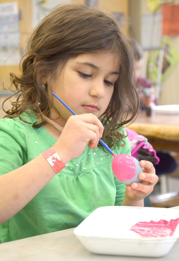 "CRAFTY — A young visitor paints a unique creation during a recent program at Rogers Center. Join Friends of Rogers at 10:30 a.m. on Dec. 15 for ""Up-Cycled Holiday Crafts."""