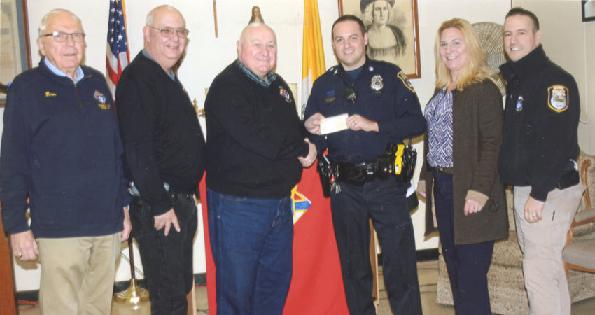 HELPING OTHERS —Members of the Rome Council 391 of the Knights of Columbus present a check for $1,000 along with 24 children's coats to members of the Rome Police Department for the annual Shop with a Cop program. From left: Ron Campbell, deputy grand knight; Dave Zasada, grand knight; Jim Mullin, council financial secretary; Patrolman Jason Fairbrother; Sgt. Sharon Rood; and Patrolman Jeff Buckley.