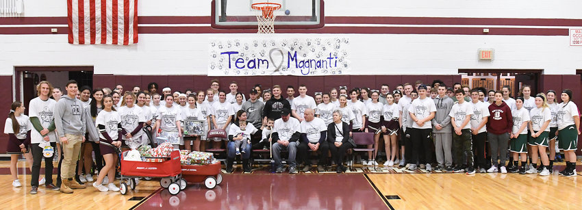 COMMUNITY SUPPORT — Students and community members came together to give the Magnanti family, of Oriskany, a good Christmas as father Kevin, Class of 1996, battles brain cancer.   Magnanti was joined by his wife Alyssa, children Augie and Rocco, and his parents at the girls' varsity basketball game Tuesday. Oriskany students and athletes raised about $2,000 to purchase gifts for the family. Outside businesses contributed greatly to the fund-raising efforts as well. The gifts were presented to the family between the junior-varsity girls and varsity girls'  games versus Hamilton.