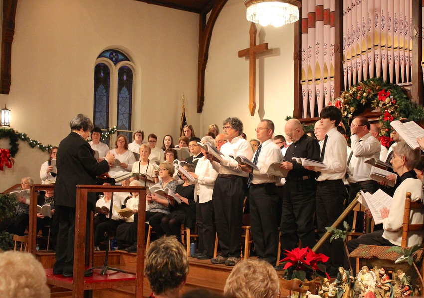 """PERFORMING — Peg Nuspliger conducts the Adirondack Community Chorus in its performance of Handel's """"Messiah"""" on Dec. 16 at the Boonville Presbyterian Church."""