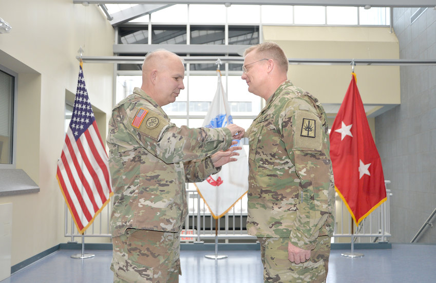 PROMOTED TO COLONEL — Col. Robert Epp, at right, is pinned by Maj. Gen. Ray Shields, the Adjutant General of the New York National Guard, during Epp's promotion ceremony at the Division of Military and Naval Affairs Headquarters in Latham on Dec. 21.