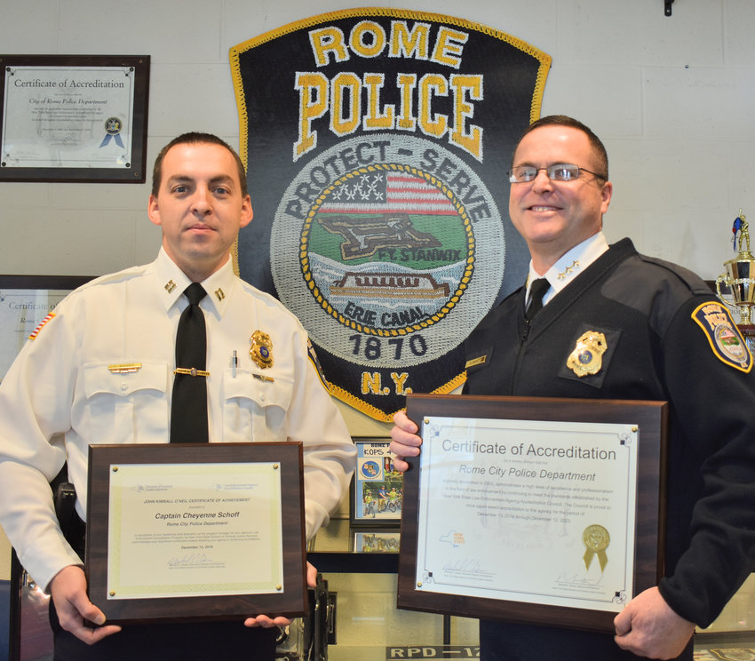 RE-ACCREDITED —The Rome Police Department has received state accreditation status for the fourth time in a row. Posing with state plaques are Captain Cheyenne Schoff, left, the department's Accreditation Manager, and Chief Kevin C. Beach.