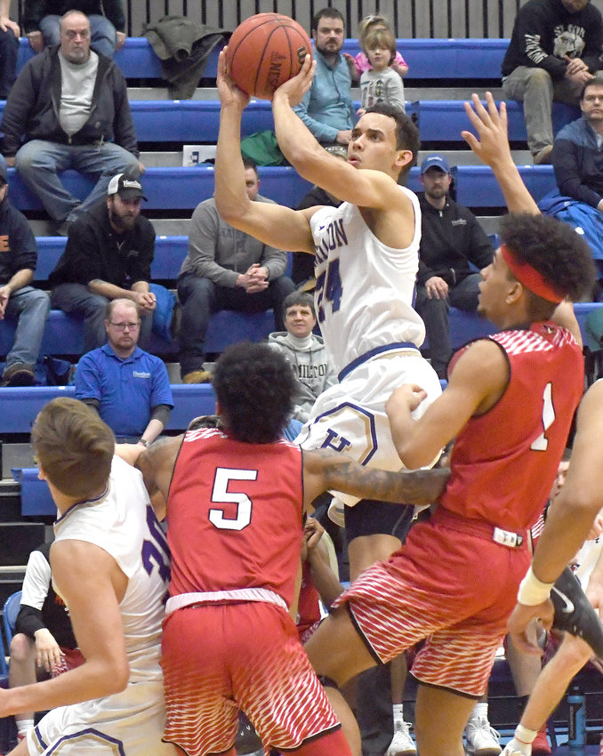 TOP SCORER —Hamilton College junior Kena Gilmour rises up to shoot against Keene State's Ty Nichols (5) and Tony Harris (1) in the first half of a non-conference men's basketball game on Jan. 3 at Hamilton College's Margaret Bundy Scott Field House in Clinton. Gilmour scored 28 points and grabbed eight rebounds as the Continentals won, 85-80.