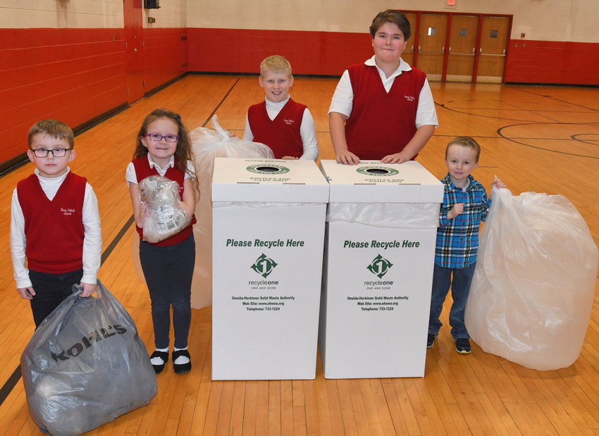 RCS COLLECTS FIRST PLACE — Rome Catholic School earned first place in the elementary school category in the third annual Plastic Film Recycling Challenge for local schools, sponsored by the Oneida-Herkimer Solid Waste Authority. Among RCS students, from left: Kameron Foley, kindergarten; Mya Dowgas, first grade; Connor Earl, fourth grade; Dylan Coleman, sixth grade; Jackson Kraeger, pre-k 4-year-old.