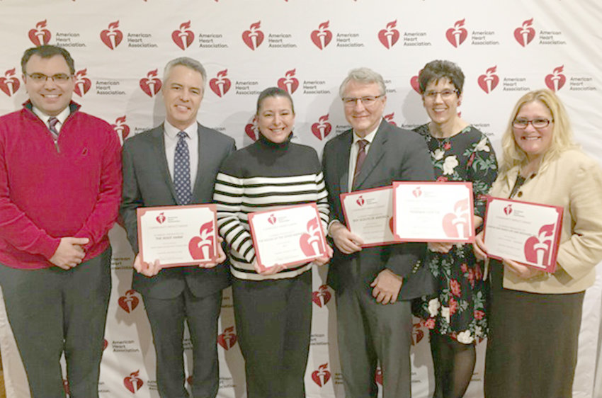GRANT RECIPIENTS — The American Heart Association announced Community Impact Grant recipients at America's Greatest Heart Run & Walk Kickoff on Tuesday. Pictured from left are Dr. Jonathan Henderson, AHA advisory board president; Pete Blanchfield, The Root Farm Executive Director; Leila Bjornland, The House of the Good Shepherd Director of Development and Communications, Dr. Frank Dubeck, Boy Scouts of America board member; Shelly Nunno-Evans, STEPS Program Coordinator; Kelly Walter, Center for Family Life and Recovery board president.