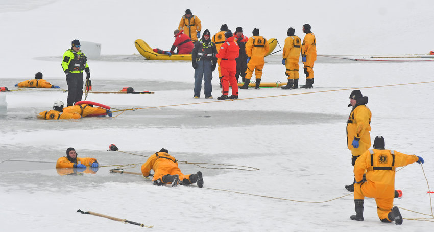 ICY CLASSROOM — Future ice water rescue trainers received their own in-field training on a frozen Delta Lake Tuesday afternoon. Once certified, these trainers will go out across the state to teach firefighters how to pull people out of icy water. See story, page 2.