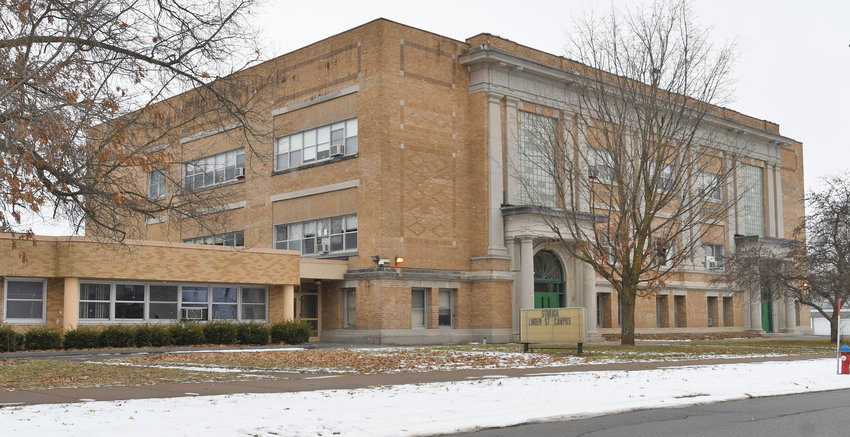 "SCHOOL BUILDING'S FUTURE UNCERTAIN — The vacant former Fort Stanwix school, 110 W. Linden St., will be reviewed by the Board of Education to determine how to proceed with the site. Closed as a regular elementary school 10 years ago, it has since been used as a temporary location for students from other schools being renovated. A sign in front says ""Strough Linden St. Campus,"" referring to its use in the past two school years by Strough Middle School students."