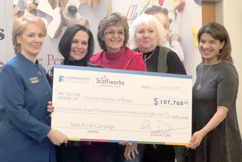 """HUMANE SOCIETY DONATION — Humane Society of Rome received an almost $107,770 donation from the Staffworks Charitable Fund """"Save a Life"""" Holiday Campaign.  From left: Staffworks Founder Anita Vitullo, Humane Society of Rome President Lynn Rosen, Shelter Manager Helene Rudiak, Humane Society Bookkeeper Sara Tuthill, and Community Foundation Director Alicia Dicks."""