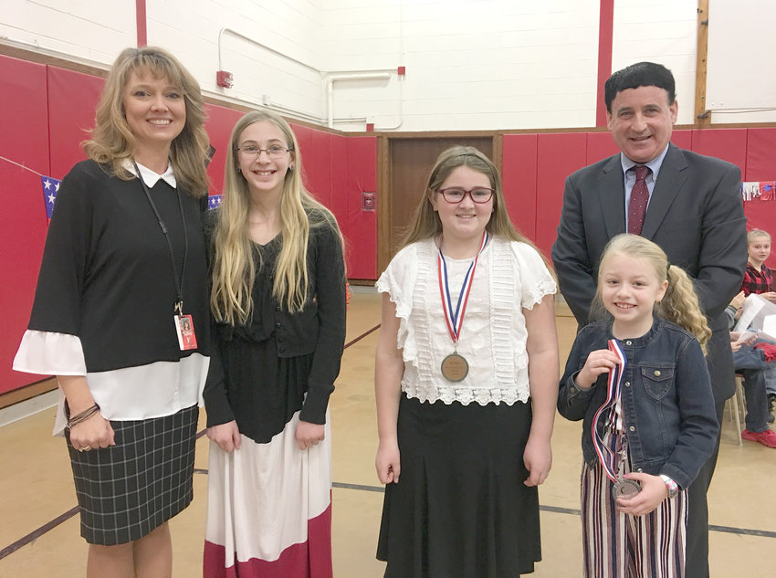 COMPETITION —A Martin Luther King Jr. oratorical competition for students was held at W.A. Wettel Elementary School in Vernon. From left: teacher Michelle Martin, who organized the event; Sarah Moyer, who tied for second place in the competition; Rebecca Schieferstine, first place; Wettel Elementary Principal Vince Pompo; Layla Murphy, who tied for second place.