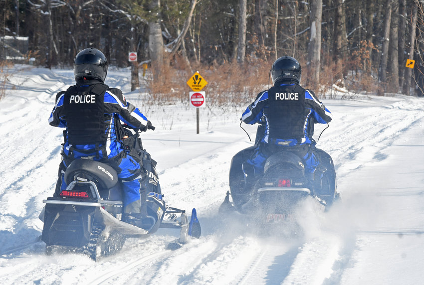 FIRST SNOWMOBILE PATROL —The Rome Police Department's Snowmobile Patrol hit the trails for the first patrol of the season this morning, now that there was enough snow to ride. Captain Cheyenne Schoff, left and Officer Jason Fairbrother launched from the Runnings parking lot on Rome-Taberg Road.