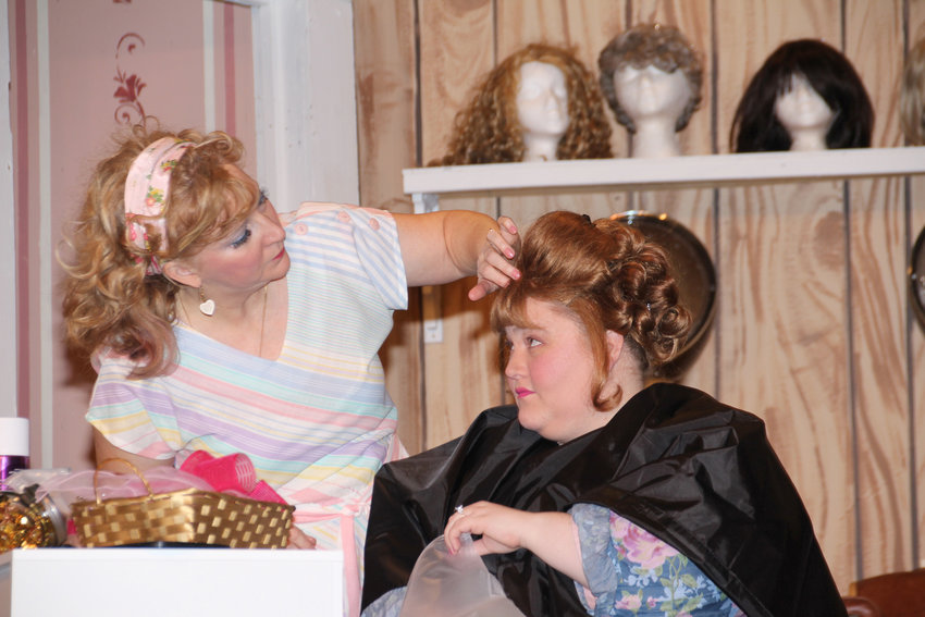 SUPERB —Actresses Kirstin Walker, left, as Truvy, and Michaela Kennedy, as Shelby, perform in a scene from Rome Community Theater's production of 'Steel Magnolias.' The production's cast received a standing ovation on opening night.