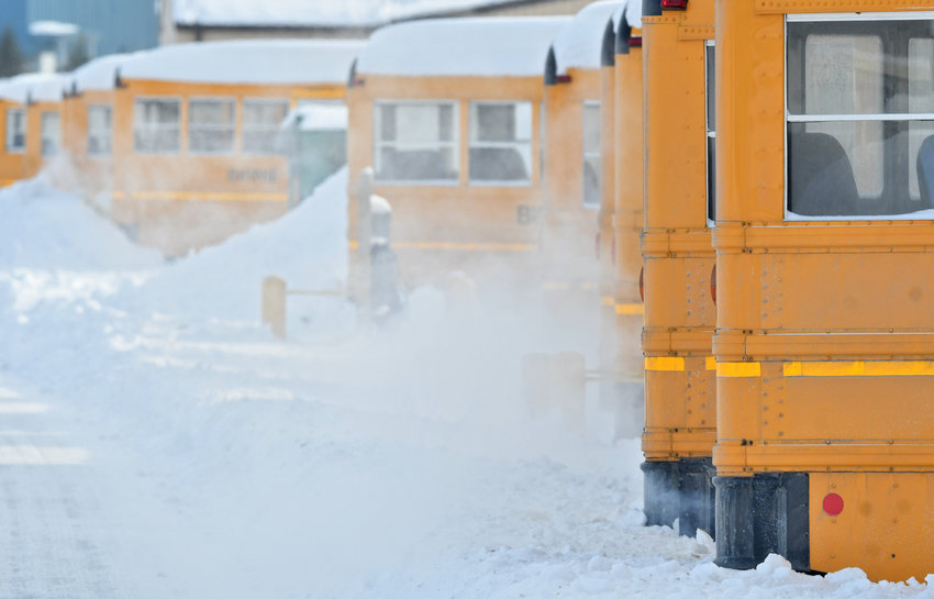 GETTING READY FOR RIDERS — Birnie Bus Service vehicles in the lot get warmed up for school on a recent winter day. A statewide report says a shortage of bus drivers is the top concern of 60 percent of school transportation directors.