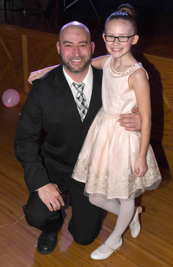 DADDY/DAUGHTER DANCE — Jason Lucynski and his daughter Avery, 10, attended Friday's Parent Teacher Organization Daddy-Daughter dance at Westmoreland High School auditorium to benefit the American Cancer Society's Relay for Life event.