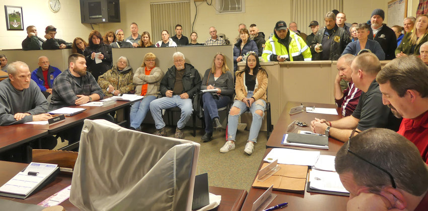 CONCERNED RESIDENTS — Oriskany village residents and volunteer firefighters packed the village offices Tuesday, Feb. 19 as questions were asked about the fire department's proposed new building that would be located at part of the old Waterbury Felt Mill.