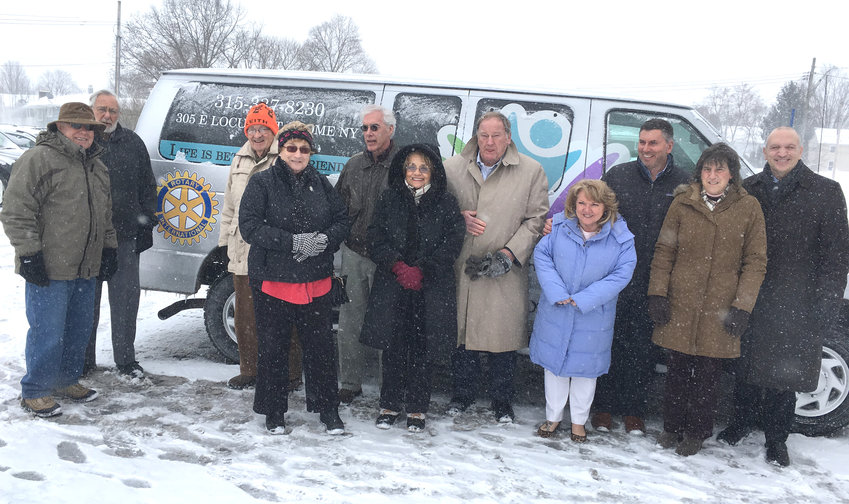 ROTARY DONATION — The Rome Rotary Club has donated a Ford F350, 11 passenger van to the Copper City Community Connection, formerly Ava Dorfman Center, 305 E. Locust St. The total value of the van, graphics and sponsorships was $20,000. The donation was made in honor of the Rome Rotary's 100th anniversary this year. From left, Rotarians Bill Tuthill, Dave Kobernuss, Keith Butters, Karen Tuthill, Dave Burke, Cara Till, Don Schlueter, CCCC executive Susan Streeter, Tony Recco, Mayor Jacqueline M. Izzo, and CCCC director David Carello.