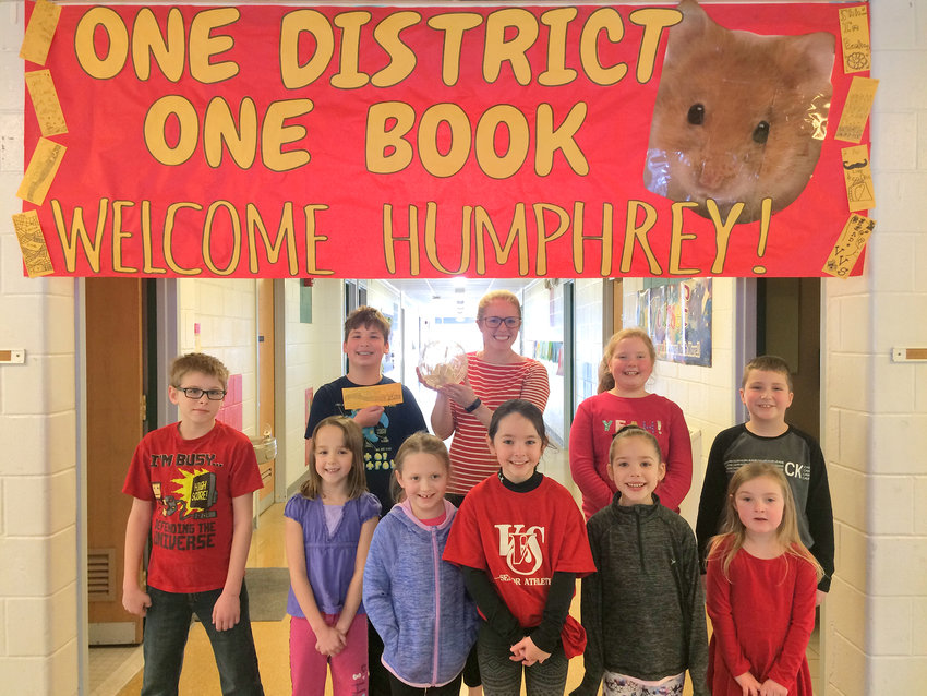 STAR OF THE BOOK — J.D. George Elementary School teacher Jordan Hadsell stands with students and their hamster, Humphrey, as part of the Vernon-Verona-Sherrill school district's launch of a One District, One Book initiative featuring the book The World According to Humphrey.