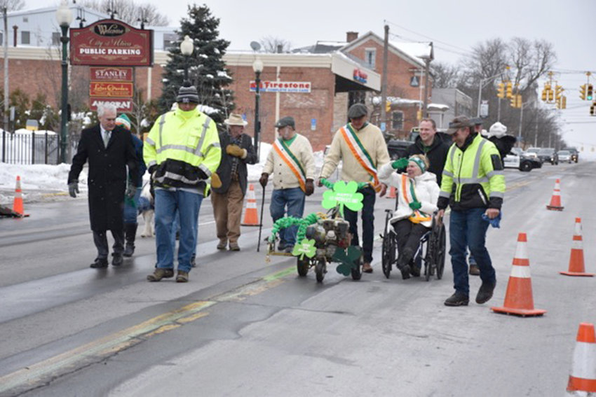 RAISING THE FLAG — A group of organizers go raise the flag of Ireland in the City of Utica.