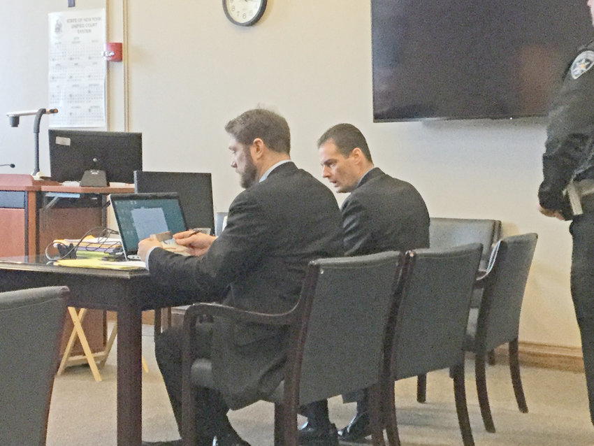"""ALMOST OVER — Accused killer John """"JW"""" Ferguson, right, chats with his attorney, First Assistant Public Defender Luke Nebush, this morning. There were two defense witnesses to be called today, and the trial testimony was expected to come to an end this afternoon."""