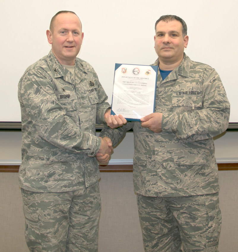 HONORED —Staff Sgt. Nino Camuglia, right, receives the Military Outstanding Service Medal from Col. Paul M. Bishop, the Commander of the 224th Air Defense Group during a recent ceremony. Camuglia received the medal for serving as part of more than 50 Honor Guard funeral details during his time with the Group.