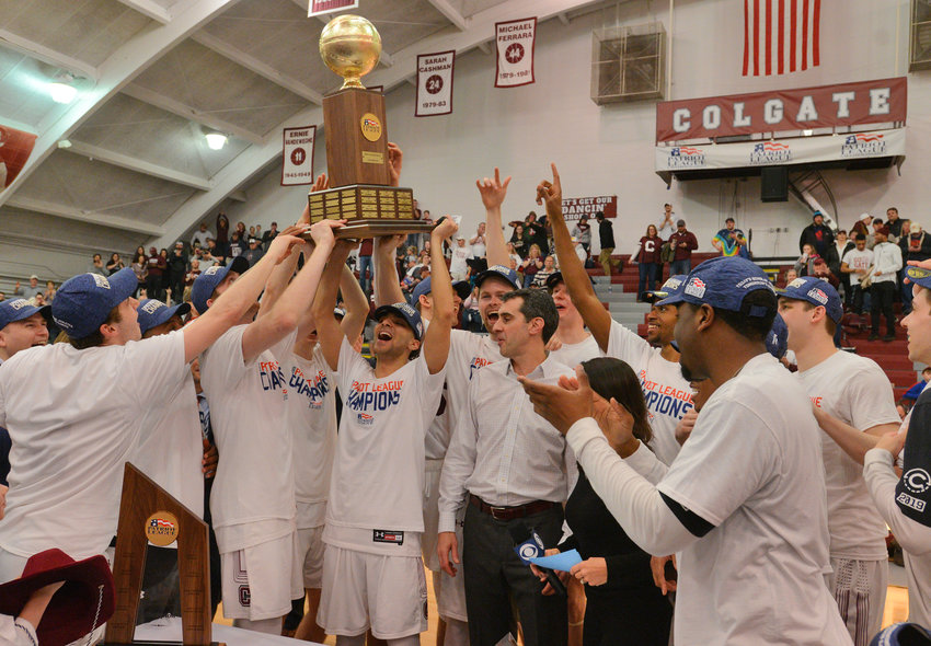 PATRIOT LEAGUE CHAMPS — Colgate players hold up the Patriot League championshiop trophy following a 94-80 victory over Bucknell on March 13 in Hamilton. The Raiders earned an automatic bid in the NCAA Tournament with the victory.