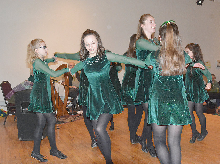 "ERIN GO BRAGH — Dancers from the Johnston Irish School of Dance entertained the crowd with the ""Circle Dance"" at the Kirkland Art Center on Saturday, March 16. The dance has been part of Irish culture since people first started to dance and is seen as an important part of bringing communities together."