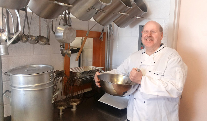 Richard Fluharty in the Annunciation Church Parish Hall kitchen.