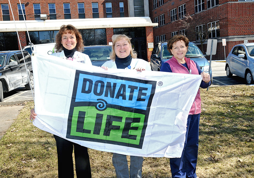 RAISING FLAGS AND AWARENESS — The Donate Life flag will fly over the Rome Memorial Hospital during April, which is National Organ Donation Month. Helping to raise the flag, and awareness of organ donations, are, from left: Patricia King, RN, CCM, CDMS, assistant vice-president Continuum of Care; Dawn Bereza, RN, CCM, case manager; and Kimberly Weiler, RN, nursing supervisor.