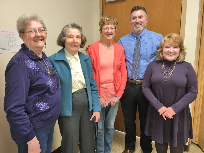 VOLUNTEER AWARDS — Top volunteers at Copper City Community Connection recently received recognition at the center's annual brunch.  From left: Edie Pendorf; Rose Blackburne; Susan Taylor, Volunteer of the Year; Tony Recchio; and CCCC Executive Director Susan Streeter. Not pictured is Pat Thron.
