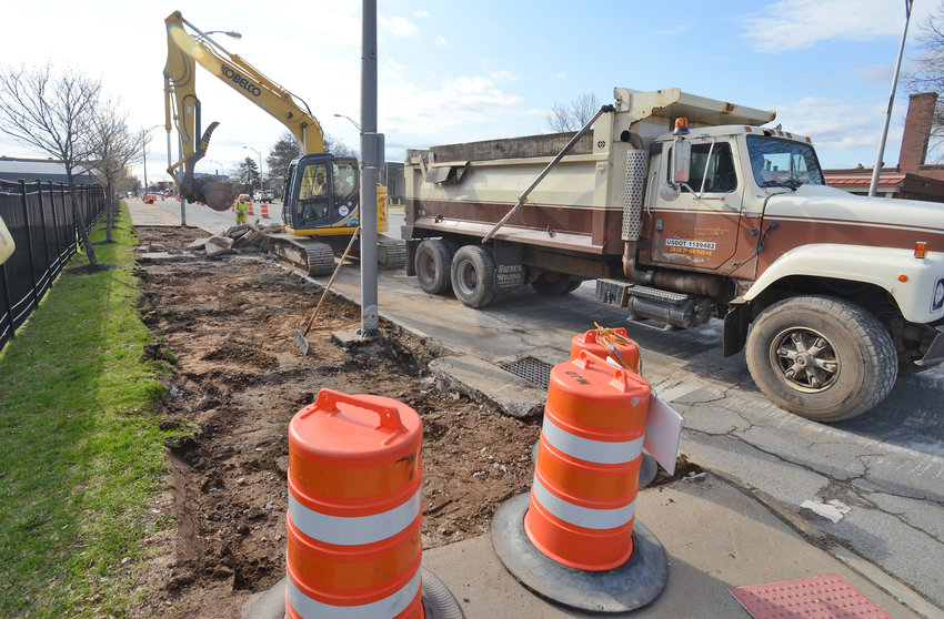 WORK BEGINS — Roadwork on West Dominick Street between George and Madison streets began Thursday morning. City workers will replace the sidewalks, curb and road, and will erect a median down the four-lane block.