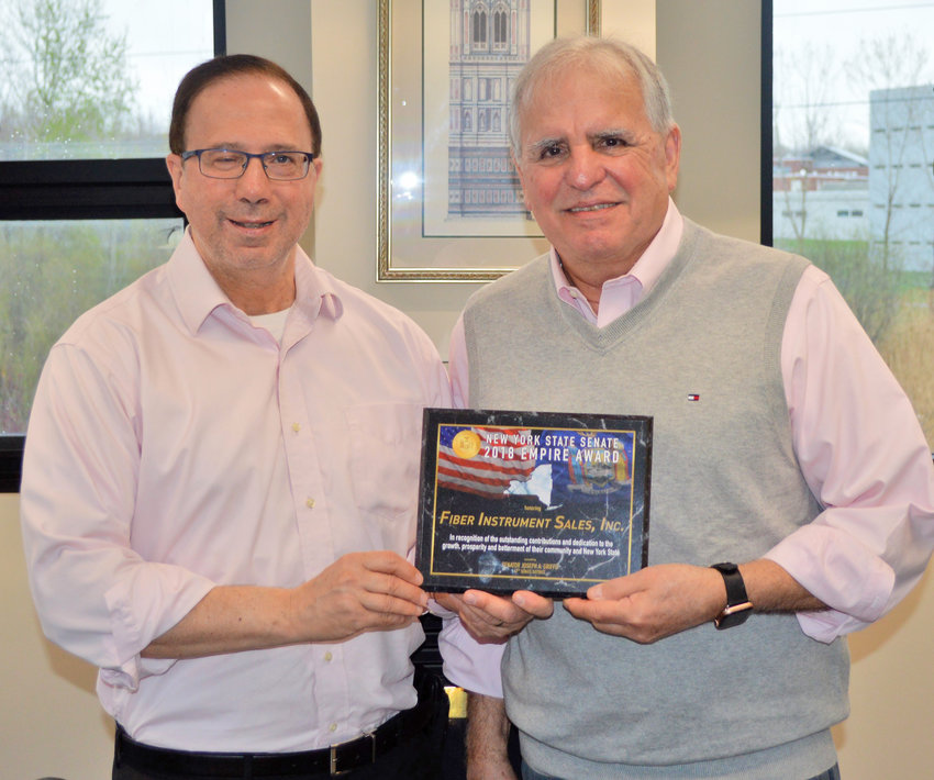 EMPIRE AWARD —State Sen. Joseph R. Griffo, R-47, Rome, left, presents Fiber Instrument Sales President Frank Giotto with a New York State Senate Empire Award.