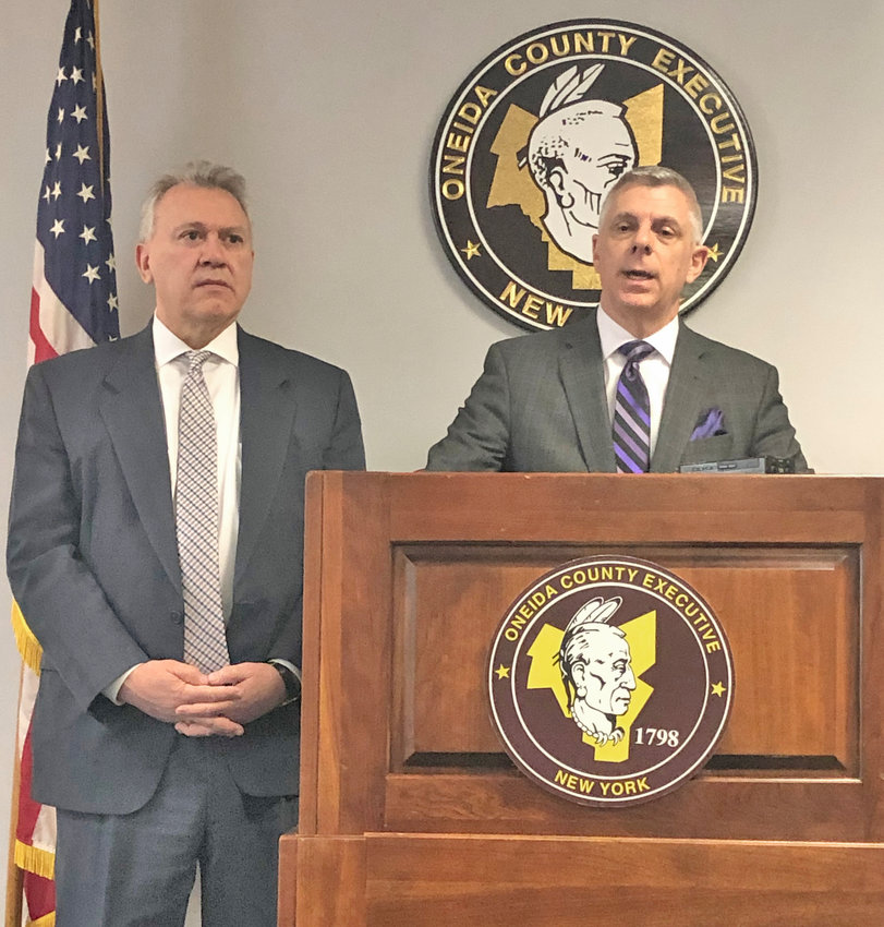 TOUTING FISCAL SUCCESS — Oneida County Executive Anthony J. Picente Jr., right, discusses the county's surplus and credit ratings during a press conference today at the County Office Building, 800 Park Ave. in Utica.