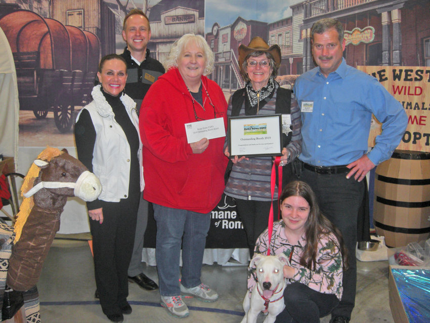 OUTSTANDING — The Humane Society of Rome's booth was recognized as 'outstanding' at the Rome Home Expo last weekend. From left to right: Lynn Rosen, society president; West Cupp, Chamber board chairman; Sara Tuthill, bookkeeper; Helene Rudiak, shelter manager; Elliott Freidman, EXPO committee chair; Angelica Mathys, cat attendant;  and Zeus, dog. (Photos submitted)