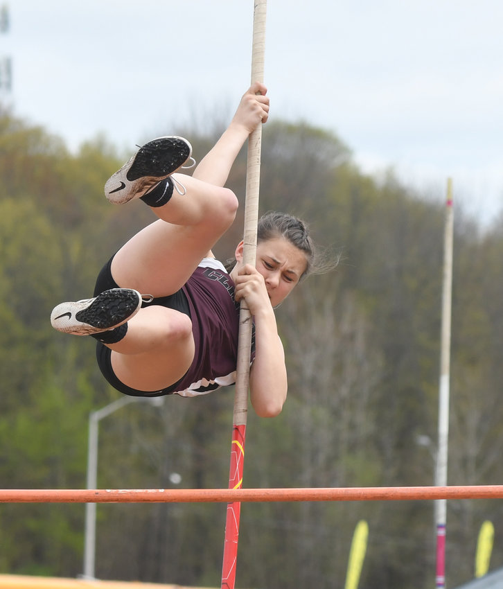 UP AND AWAY — Clinton pole vaulter Claire Barone makes a vault at the Copper City Classic Girls Track and Field Invitational on Saturday, May 4 in Rome. She placed third in the event and the school finished third out of 14. Camden won the overall meet.