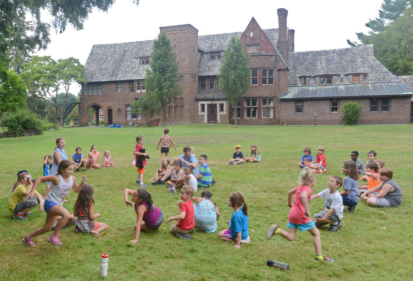 SUMMER CAMP —Participants in the Artletics Summer Camp program at the Rome Art & Community Center have some fun in the sun last year playing Duck Duck Goose.