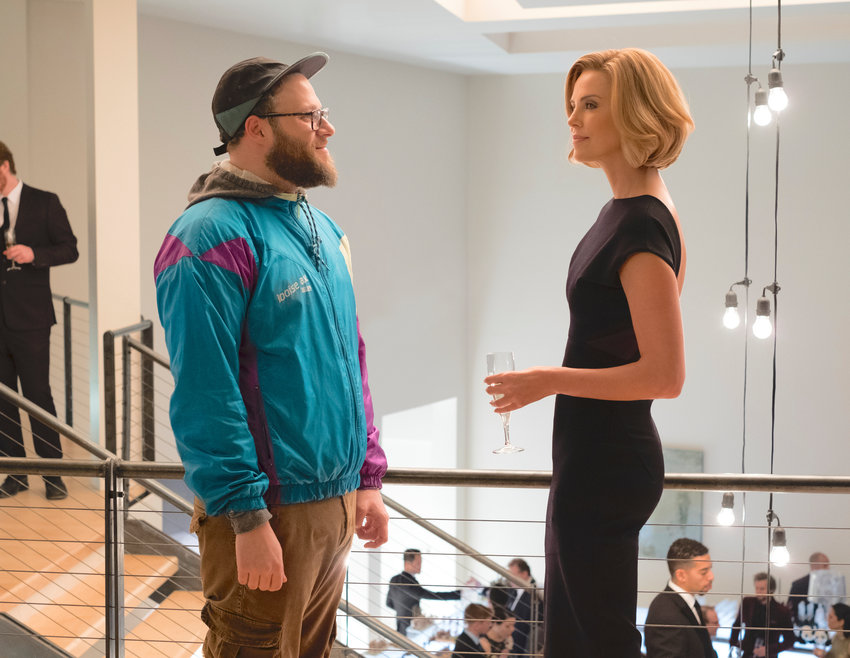 "ROM COM — Seth Rogen, left, and Charlize Theron in a scene from ""Long Shot."""