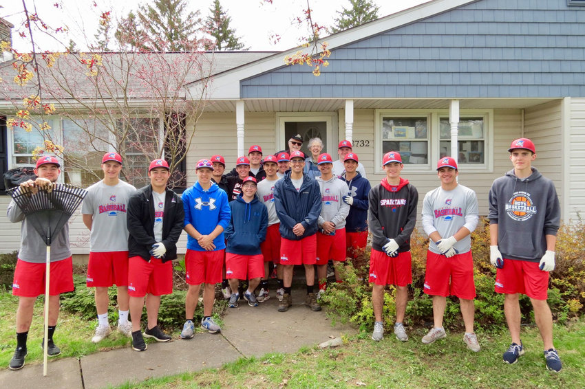 SPRING CLEANING — Members of the New Hartford Spartans varsity baseball team poses in front of a residence they cleaned up on Snowden Hill Road in New Hartford.
