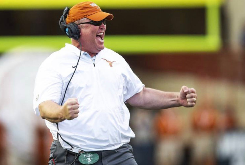 HOOK 'EM HORNS — Westmoreland native Herb Hand celebrates on the sideline of the University of Texas at Austin where he serves as Longhorn football co-offensive coordinator/offensive line coach. Hand's football career began as a player at Westmoreland High School in the mid-eighties, continued to Hamilton College as a player in the late-eighties and he's been working on the sidelines and football practice fields as a coach ever since.