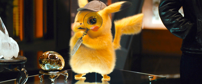 "ON THE CASE — The character Detective Pikachu, voiced by Ryan Reynolds, in a scene from ""Pokemon Detective Pikachu.""  ""Reynolds, as a cute coffee-guzzling detective with a Sherlock Holmes' deerstalker cap, ping-pongs from heartfelt to caustic uneasily and tries to mimic his best-known, fourth-wall breaking ""Deadpool"" movie character."""