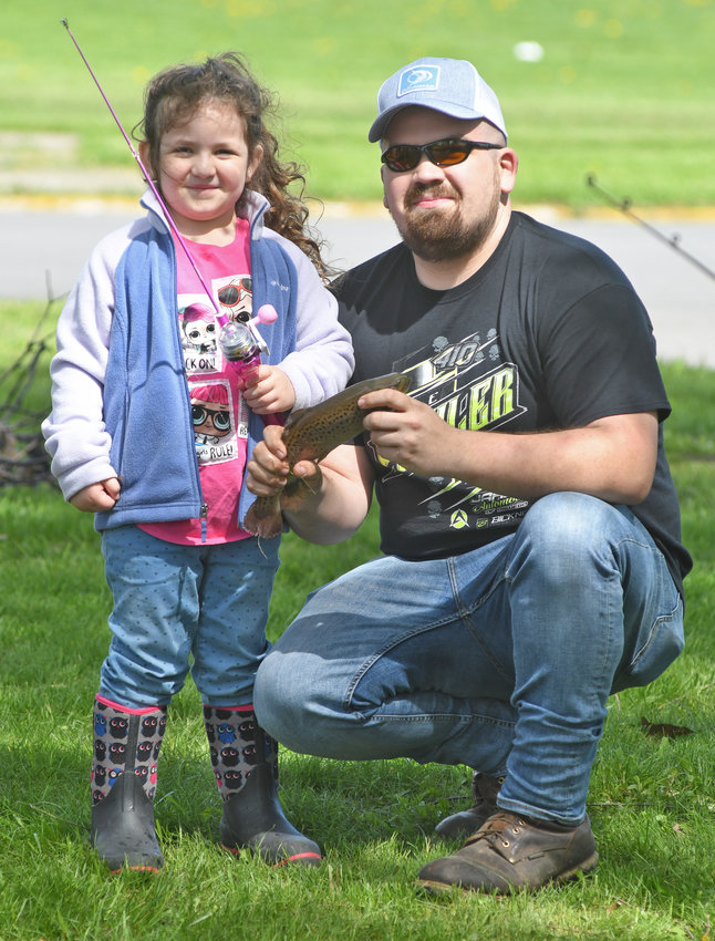 BIG CATCH — Tyler Hall and his daughter Braelynn proudly display the fish they caught at the Rick LeFevre Fishing Derby at Guyer Field on Saturday.