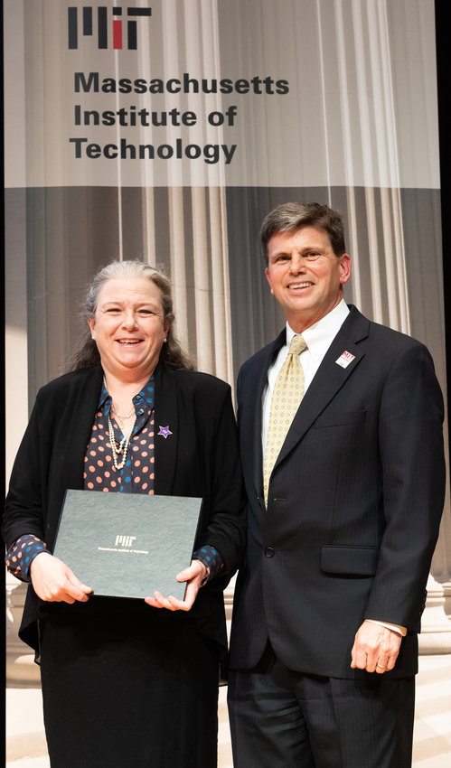 EXCELLENCE AWARD — Clinton native Emily Gallagher, left, faculty assistant of the Economics Department at the Massachusetts Institute of Technology, receives the Outstanding Contributor Award of Excellence from the college.