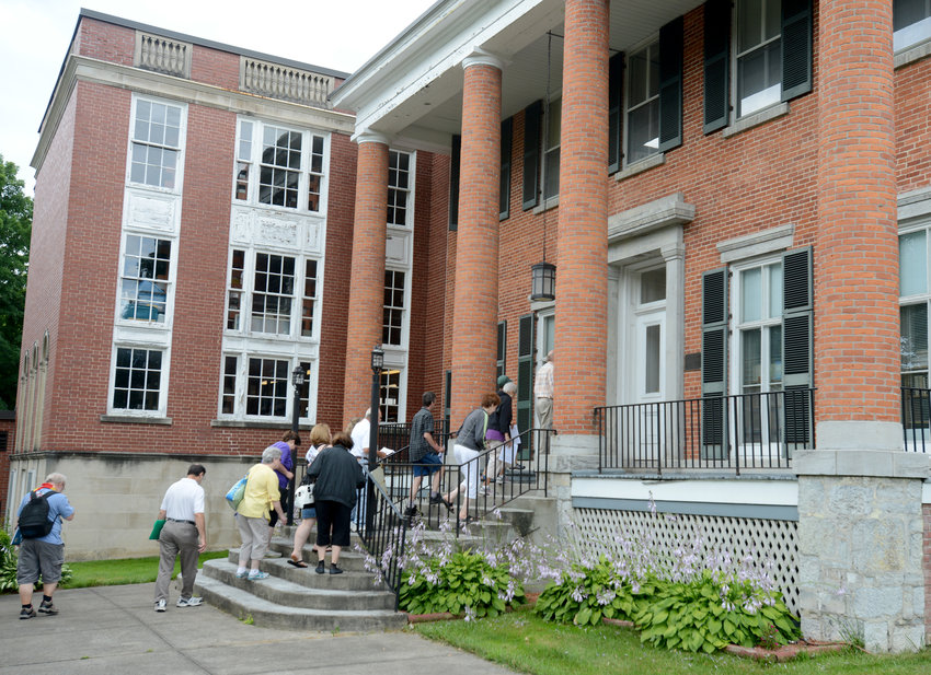 HEADING IN — Participants on a free tour head inside after viewing outside details of the Greek Revival-style 1858 Jervis House, 613 N. Washington St. in this 2017 file photo. While known by many for its vast collection of books, DVDs, CDs and other media, the library's Jervis House is on the National Register of Historic Places.