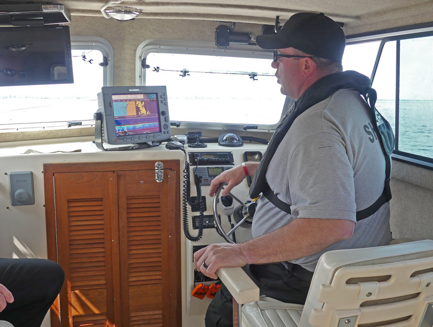 MARINE PATROL — Sheriff's Sgt. Scott Kahl pilots Marine 1 onto Oneida Lake following Wednesday's safety announcement. The boat is equipped with radar, infrared cameras and computer equipment. The Marine Patrol has five boats and three personal water crafts in its fleet.