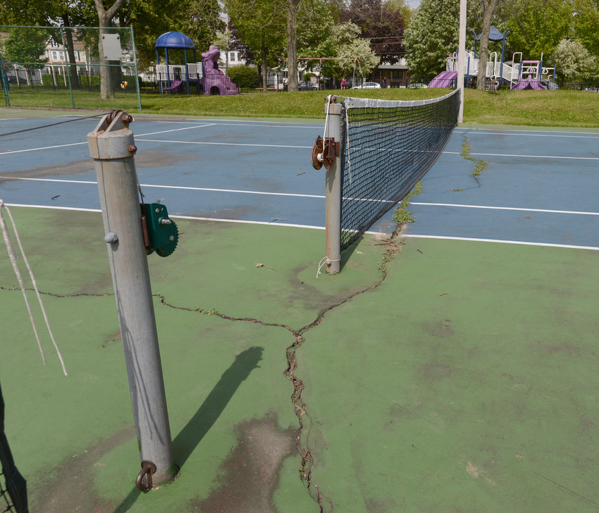 "REPAIRS NEEDED — Cracks at Franklyn's Field tennis courts will be repaired using leftover grant money from 2013, Parks and Recreation Director James Korpela told the Common Council Wednesday night. The courts were repaired at that time, but Korpela said the city didn't get ""our money's worth,"" and that a different, more permanent technique would be used to seal the cracks."