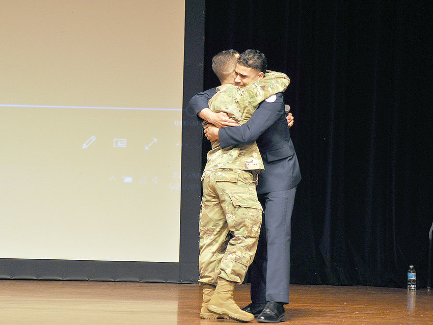 BROTHERLY EMBRACE — Army Sgt. Vince DiGioia and his little brother, Rome Free Academy JROTC cadet William Almas, share a hug after DiGioia made a surprise appearance at the RFA JROTC Award Ceremony Thursday night.  The brothers had not seen each other in four years.