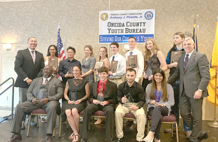 YOUTH AWARDS — Recipients of the second annual Oneida County Youth Awards pose with county leaders at the awards dinner. Pictured are from left on the back row are Oneida County Youth Bureau Director Kevin Green, Jamilex Neris, Gu Nay Ku, Nicole Weis, Madeline Peyton, Matthew Pietryka, Michael Stappenbeck, Molly Williams, Nicholas Clayton and County Executive Picente Jr. On the front row from left are Connecting Our Community Award winner Walt Savage, Arianna Westfall, Blair Kahler, Jacob Cooper and Maheen Qureshi.