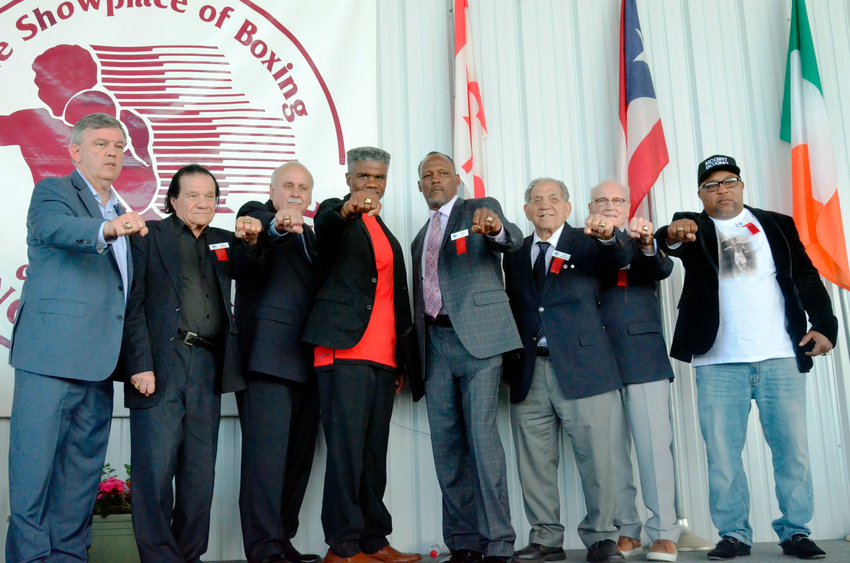 RING CEREMONY — From left to right, International Boxing Hall of Fame Class of 2019 inductees Teddy Atlas, Don Elbaum, Lee Samuels, Julian Jackson, Donald Curry, Tony DeMarco, Guy Jutras and Buddy McGirt display their IBHOF rings during the induction ceremony on Sunday, June 9 in Canastota.
